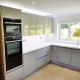 Handleless kitchen supplied by Taps and Tubs
